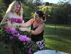 Model Christy Taylor with Julia Rose, of Sleepy Hollow, who makes dresses using fresh flowers.