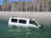 ONE unlucky driver has had their automobile added to the Fraser Island seascape after rising water engulfed a van in Coongul Creek.