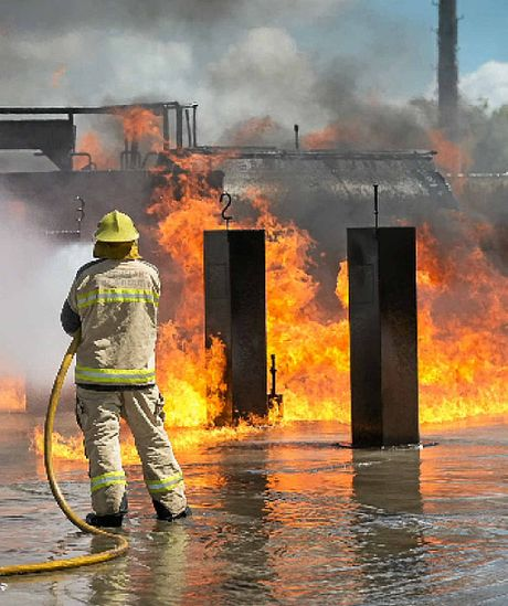 A fire fighter puts out a simulated tanker fire.