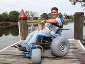 TWEED resident Tim Thomas, who was born with cerebral palsy, has welcomed the launch of a fourth beach wheelchair in Tweed Shire this week.