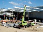 DESPITE last week's deluge, Bunnings says work on its imposing new warehouse on Brisbane St, West Ipswich, is on track.