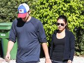 MILA Kunis and Ashton Kutcher flew to Iowa to show his family her growing baby bump over the weekend.