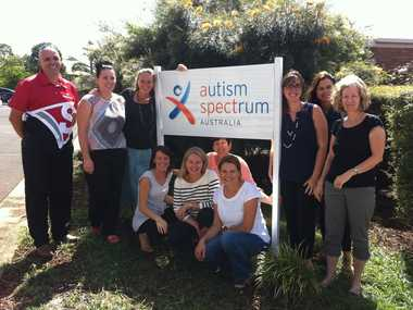 Autism Spectrum Australia's new sign, surrounded by staff from the Alstonville not-for-profit organisation and Jason Goulding from Casino company Signarama, which replaced the sign.