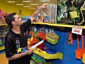 Phillip Gatfield at work at Mackay's Toyworld store, which will close its doors on May 18.