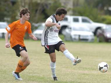 Richmond Rovers striker Jonathan See slams a shot at goal during the clash against Lennox Head Sharks.