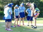 GROWING ATTENTION: Neville Austin helps a group of Raceview State School kids learn about the benefits of golf.