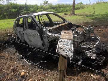 A man is on the run after dumping and torching a stolen BMW in Tiaro.