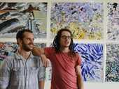 Sydney artists Emilio Cresciani (left) and Zachariah Fenn in front of Emilio's work.