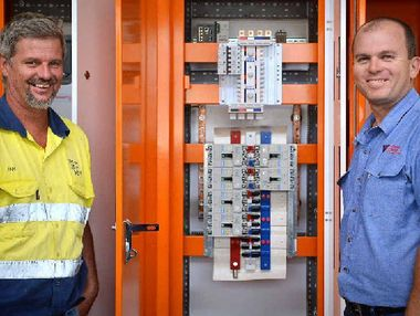 EXPORT MARKET: PHE switchboard engineering manager Ben Fitzpatrick (right) with Tritton Sheet Metal managing director Ian Tritton, in front of a locally manufactured switchboard, destined for Brunei.