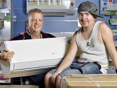 GENEROSITY: Good Guys' Mark Timms has donated an air-conditioning unit to Chris Hobart.