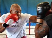 Alex Leapai spars ahead of his world heavyweight title bout in Germany.