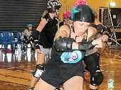 READY TO RUMBLE: The Airlie Beach Trashbags are looking forward to hosting an epic three-round roller derby clash this Saturday, April 26. This is Sarah 'Brig-Hit Bardo' Savage breaking through the line during a training session.