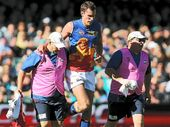Lion Matthew Leuenberger limps from Adelaide Oval on Saturday.
