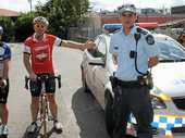 NEW LAWS: Local cyclists Grant Reid and Brian Taylor with Gatton Police Constable Ethan Bailey demonstrate the 1m and 1.5m wide distances drivers have to obey with the new State Government laws.