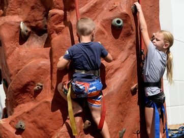 The rock climbing wall at Sugarland Shopping Town was popular with the Easter holiday shoppers.