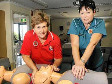 IN TRAINING: Rae Guyder and Vanessa Browning from LAC practice their CPR skills.