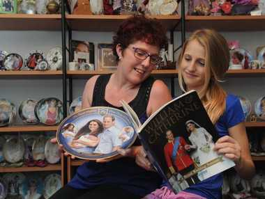 Julieanne Reid and her daughter Ebony with some of her royal collection.
