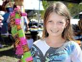 Kyra Hughes, 11, from Hervey Bay with a colourful giraffe from Madagascar at the Toogoom Easter Fair.
