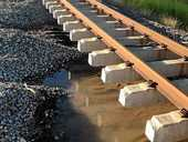 WASHOUT: The ballast is washed from around concrete sleepers under the tracks at Mookarra, south of Bowen.