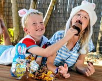 Gypsy McCormack, 8, and brother Ryder, 5, of Mountain Creek, tuck into a chocolate Easter egg, but experts are warning not to eat too much.