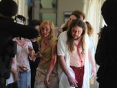 Leading zombie actors, Tasharni Brown and Jacob Severs, are confronted by mercenaries in the halls of the Maryborough Base Hospital. The zombie production is directed by Nick Aiton.