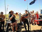 STANDING TOGETHER: Nahko and Medicine For the People perform at the Bentley protest site in Lismore yesterday.