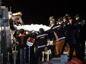 The body of a passenger aboard the Sewol ferry which sank in the water off the southern coast, is carried by rescue workers upon its arrival at a port in Jindo, south of Seoul, South Korea, Saturday, April 19, 2014.
