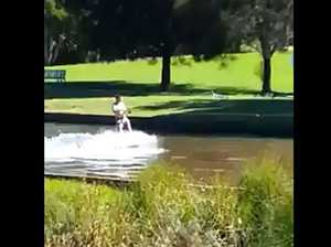 A screenshot of a video of wakeboarders in West Creek Reserve, Kearneys Spring.