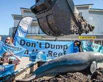 STRONG MESSAGE: Dredged muck was dumped in front of former Prime Minister Kevin Rudd's Brisbane office to protest dredging near the Great Barrier Reef.