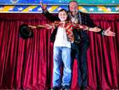 ROLL UP: A huge fan of the circus, an excited Luke James, 8, meets Stardust Circus ringmaster Adam. Luke wants to join the circus and is learning how to ride the unicycle. Luke's favourite acts were the lions, the flying trapeze artists and the springboard troupe.