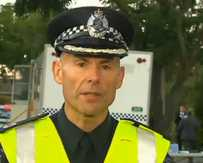 Victoria Police Assistant Commissioner Andrew Crisp speaks to the media at the scene.