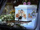 SKY blue and painted with flowers and clouds, a coffin containing the body of Peaches Geldof was today carried into a12th-century church in Kent.
