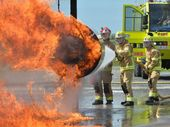 Fire Commander David Tromba runs new recruits Colin Rossiter and Linden Rosier through a live fire excercise.