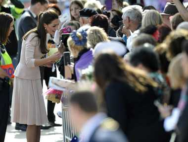 Kate, the Duchess of Cambridge, greets the crowd. Wednesday, April 23, 2014, in Adelaide, Australia. The royal couple, along with their son Prince George, are on a 10-day official visit to Australia.