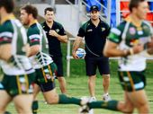 SHARP EYES: Ipswich Jets co-coaches Ben (left) and Shane Walker watch their team warm up before upstaging Northern Pride at the North Ipswich Reserve last Saturday night.