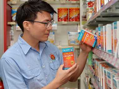 Sydney St's Red Apple Chemist pharmacist Mike Yang says those seeking a vitamin D supplement should get one with calcium to help the body absorb calcium more effectively.