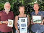 RECOGNISED: Airlie Beach RSL deputy president Bill Rose and former Naval chief petty officer Peter McKellin (left and right) with Bowen resident Vicki Birkhead (centre) holding memorabilia from the HMAS Yarra II, on which Vicki's grandfather, Bruce Cairncross, served during World War II. Ms Birkhead will accept a gallantry citation insignia on behalf of her grandfather today on ANZAC Day.