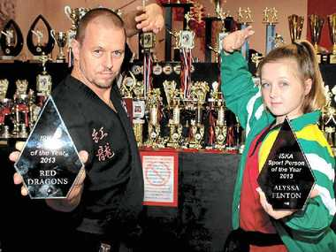 HARD WORK: Red Dragon Martial Arts sifu Brett Fenton and daughter Alyssa celebrate the club's success at the recent International Sports Karate Association awards night.