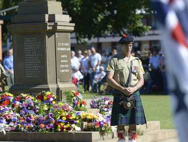 "REMEMBRANCE: Corporal ""Forrest"" Harrington in position in the catafalque party during the daytime Anzac Day service at Memorial Park. Photo JoJo Newby"