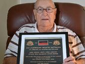 IT'S A MUST: Ex-serviceman Owen Treadwell reminisces at home in Coolum.