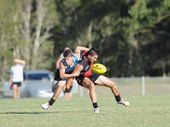 Aussie Rules - Bombers V. Bay Power. (L) Scott Burden puts a tackle on James Falkenberg.