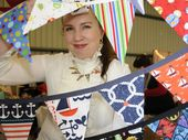 Mummy Tree Markets: Selling beautiful bunting at the Mummy Tree Markets is Marissa Paki. Photo: Bev Lacey / The Chronicle