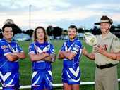 Shaping up for the ANZAC games - Wallaroos' Damien Otto, Matthew Walker and Billy Connell with 9RQR Delta Company's Lance Corporal Glenn Kelly.