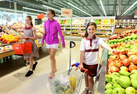 Ipswich Coles customers Leah Petersen of Raceview with her daughters Emily, 11, and Hayley, 9.