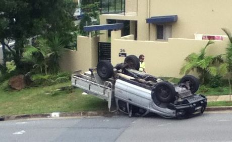 Overturned ute on pedestrian crossing