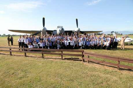 Flying school students in front of the Mosquito