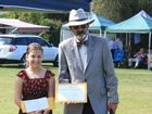 Cancer Survivor Natalia received donation from club president, Les Funch.