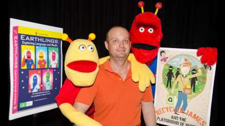 Jim Hancock with puppet aliens Milton and Harvey.